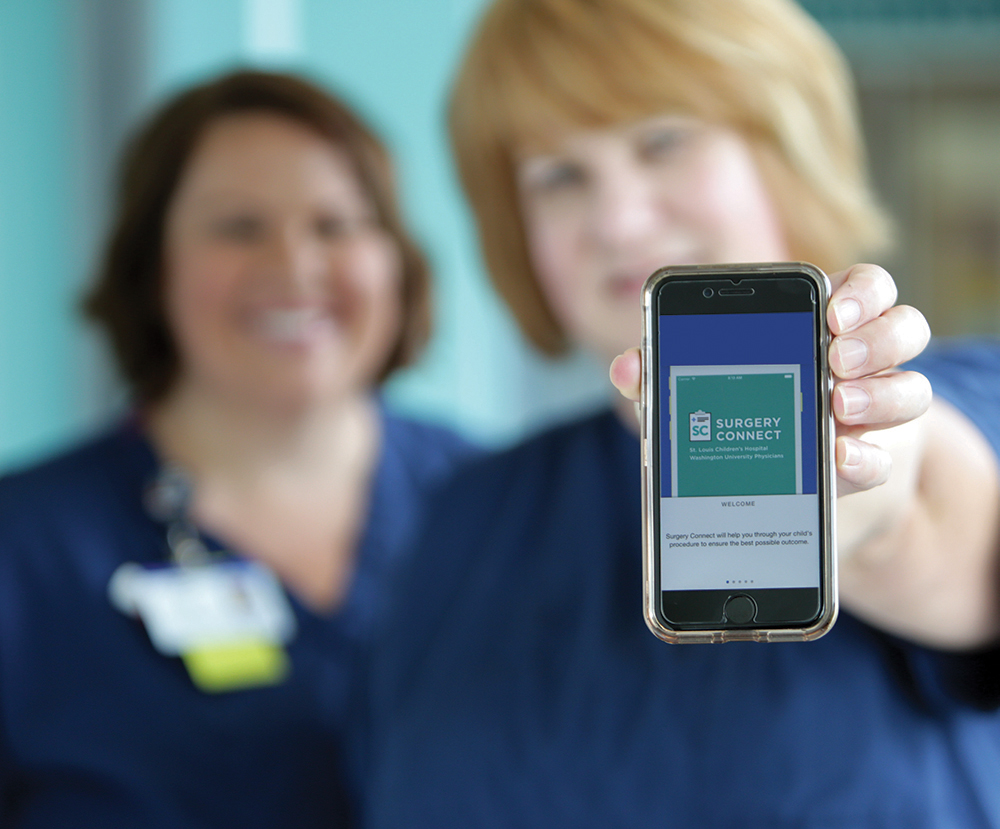 Nurse holding smart phone with surgery app built by AppCatalyst for St. Louis Children's Hospital Speciality Care Clinic